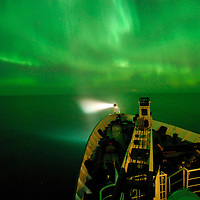 Northern lights or Aurora borealis on the Arctic night sky, viewed from Orlova Russian Icebreaker, High Arctic. Canada&amp;#xA;( night, nocturnal, show, colorful, green, red, spectacule, weather, atmosphere,<br />