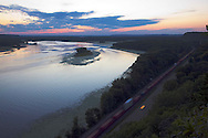 Just after the sun had sunken below the far horizon, a BNSF intermodal train rolls north along the shore of the mighty Mississippi River on it's way to Minneapolis and the West Coast.