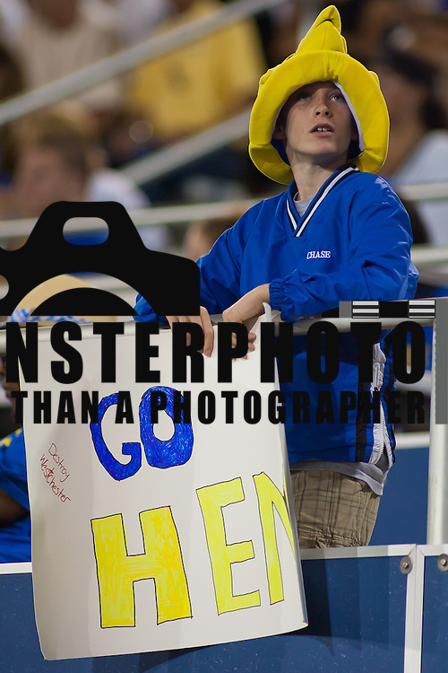 A young Delaware fan holds his sign while looking at the replay on the score board during a Week 2 NCAA football game against Westchester in the fourth quarter. ..#8 Delaware defeated Westchester 28-17  in their home opener at Delaware Stadium Saturday Sept. 10, 2011 in Newark DE...Delaware will return home Sept. 17, 2011 for a showdown with interstate Rival Delaware State at 6:pm at Delaware Stadium. (Monsterphoto/Saquan Stimpson)