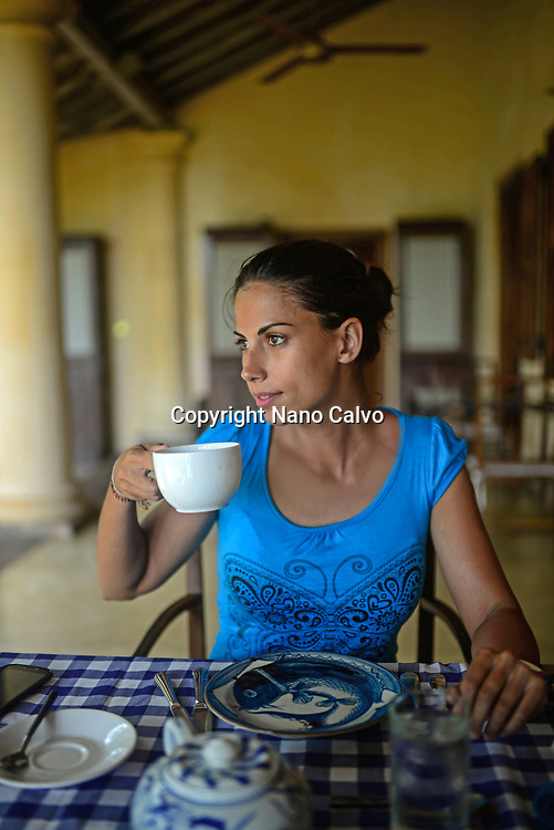 Young attractive woman having breakfast in The Dutch House hotel, Galle, Sri Lanka