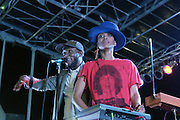 August 25, 2012-Brooklyn, NY: (L-R) Recording Artist Yasiin Bey aka Mos Def and Recording Artist Erykah Badu perform at the Afropunk Festival 2012 held in Brooklyn, NY on August 25, 2012. The Afropunk Festival has become a Brooklyn intuition, the focal point for the burgeoning Afro-punk movement. Over the past seven years, the festival has presented new artists before they hit it big, such as Grammy-nominated Santigold, The Noisettes and Janelle Monae. Afro-punk mainstays like Saul Williams, The Dirtbombs, and Dallas Austin have also graced Afro-punk's stages. (Terrence Jennings/TerrenceJennings.com)