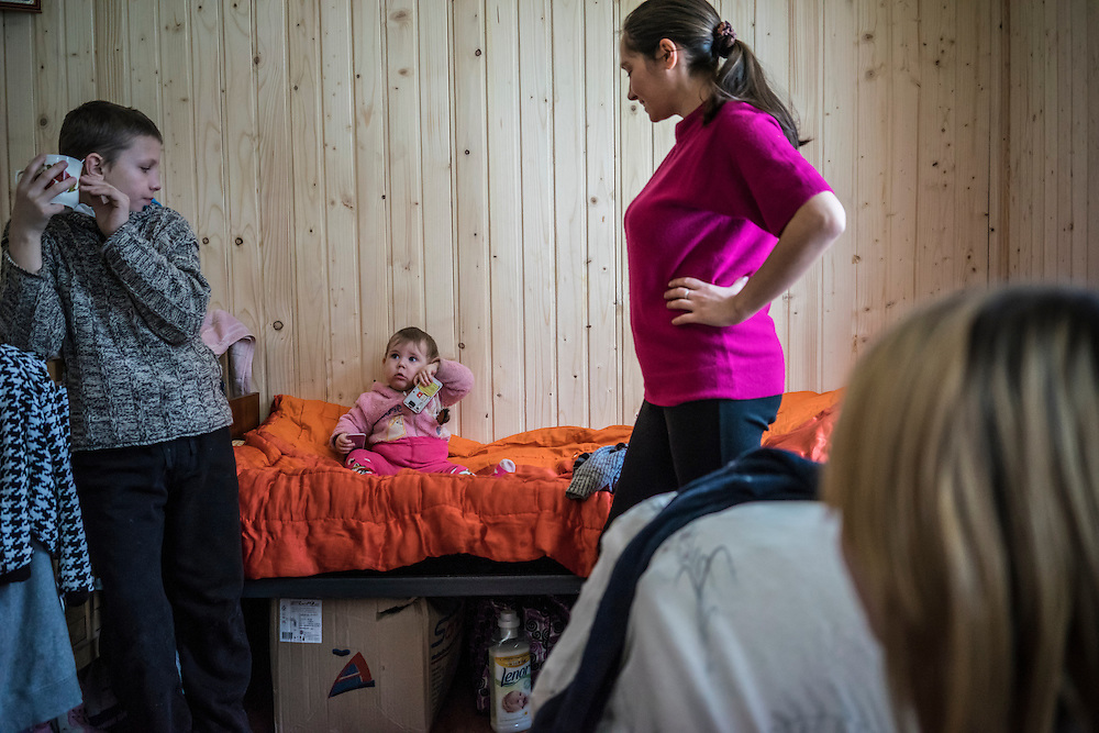 A family at Romashka, a summer camp where they and several hundred other people live after being displaced by fighting in Eastern Ukraine on Friday, February 13, 2015 in Kharkiv, Ukraine.