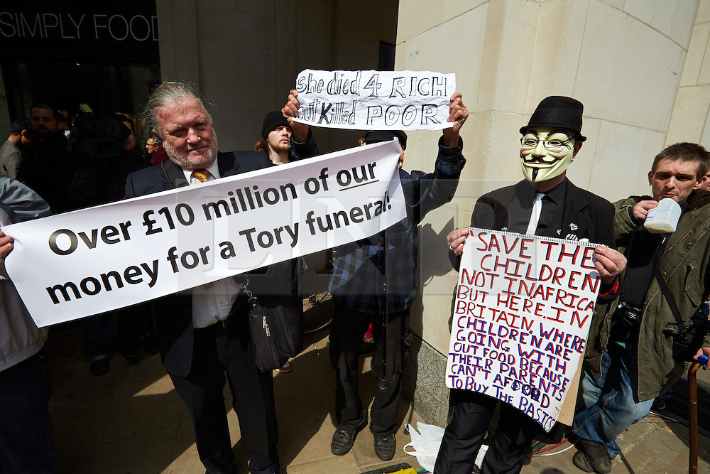 © Licensed to London News Pictures.  17/04/2013. LONDON, UK. Protesters hold placards outside St Paul's Cathedral after the funeral of former Prime Minster Margaret Thatcher. Photo credit: Cliff Hide/LNP