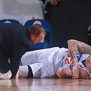 Delaware 87ers Center JORDAN RAILEY (32) lays on the court in pain as Delaware 87ers Trainer CHAD MCKEE assists in the first half of a NBA D-league regular season basketball game between the Delaware 87ers and the Maine Red Claws Friday, Feb. 19, 2016 at The Bob Carpenter Sports Convocation Center in Newark, DEL.