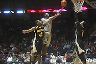 """Ole Miss forward Terrance Henry (1) shoots as Southern Mississippi forward Gary Flowers (4) defends at C.M. """"Tad"""" Smith Coliseum in Oxford, Miss. on Saturday, December 4, 2010. Ole Miss won 86-81."""