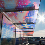 """glass wall art. The """"Seattle Cloud Cover"""" glass bridge art was completed in 2006 by Teresita Fernández (born 1958). Seattle Art Museum's Olympic Sculpture Park opened in 2007 at the southern end of Myrtle Edwards Park. Free entry. Address: 2901 Western Avenue, Seattle, Washington 98121"""