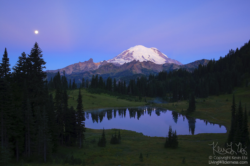 The full moon sets near Mount Rainier and Tipsoo Lake, located near Chinook Pass, Washington.