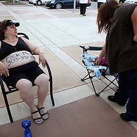 """Shelly Wright (L) is third in line with """"Pick Me"""" and her phone number written on her belly for casting for season 11 of """"The Biggest Loser"""" television show in Broomfield, Colorado July 17, 2010. Wright spent the night on the sidewalk outside the hall for a chance to be on the show and win $250,000.  Over 600 people attended the casting call.   REUTERS/Rick Wilking (UNITED STATES)"""