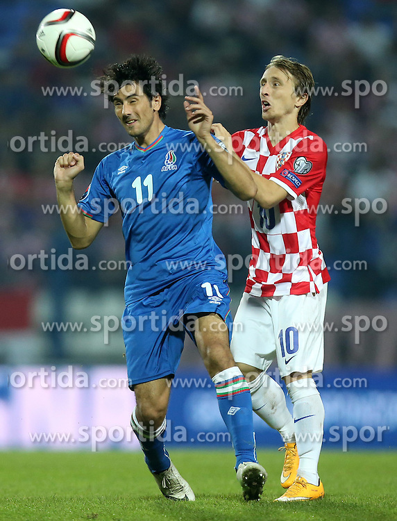 13.10.2014, Stadion Gradski vrt, Osijek, CRO, UEFA Euro Qualifikation, Kroatien vs Aserbaidschan, Gruppe H, im Bild Rauf Aliyev, Luka Modric // during the UEFA EURO 2016 Qualifier group H match between Croatia and Azerbaijan at the Stadion Gradski vrt in Osijek, Croatia on 2014/10/13. EXPA Pictures &copy; 2014, PhotoCredit: EXPA/ Pixsell/ Igor Kralj<br /> <br /> *****ATTENTION - for AUT, SLO, SUI, SWE, ITA, FRA only*****