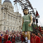 The Giants Spectacular parades through the city centre streets of Liverpool UK