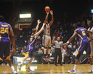 "Ole Miss guard Zach Graham (32)  shoots as Louisiana State's Matt Derenbecker (21) shoots at the C.M. ""Tad"" Smith Coliseum in Oxford, Miss. on Wednesday, February 9, 2011. Ole Miss won 66-60 and is now 4-5 in the Southeastern Conference."