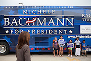 GOP Presidential candidate Rep. Michele Bachmann walks out to her campaign bus after a town hall event in Marshalltown, Iowa, July 23, 2011.