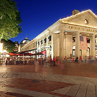 Boston Quincy market near Faneuil Hall Marketplace is popular with locals and tourists for its food stalls, restaurants and shopping areas. After sunset twilight paints the sky blue while the city lights around Quincy Market become alive.<br />
