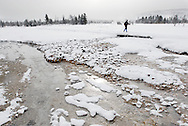 A cross-country skier glides along the trail through the Upper Geyser Basin near Old Faithful in Yellowstone National Park.