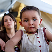 Muhamed, 3, with his sister, Fatimah, 13, from Aleppo, Syria, live in Ritsona refugee camp. They and their family have been stranded in Greece since the Balkan borders were closed to refugees in March 2016.
