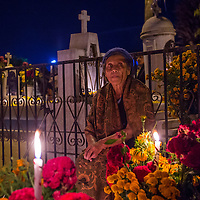 OAXACA , MEXICO - NOV 02 : Unidentified woman on a cemetery during Day of the Dead in Oaxaca, Mexico on November 02 2015. The Day of the Dead is one of the most popular holidays in Mexico
