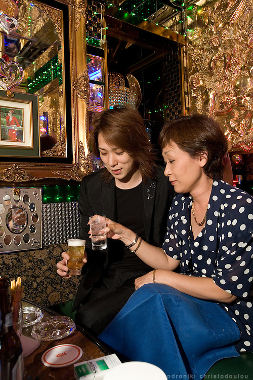 "Yumi (R) drinking with her host Shun (L) in club ""Ai"". Club ""Ai"" (love in Japanese) is one of the oldest host clubs in Kabukicho entertainment area near Shinjuku. It started functioning 37 years ago, with hosts ready to take care of the needs of their female customers. The customers have to pay from 5000 friendly price for beginners, to millions of yen, depending on how good the host is in pleasing the customer and encouraging her to buy drinks. On top of these a good host can receive expensive gifts from his regular customers.  Tokyo - JAPAN"