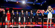Ayla Brown sings the National Anthem as Republican presidential candidates (L-R) Ohio Governor John Kasich, businesswoman Carly Fiorina, Florida Sen. Marco Rubio, retired neurosurgeon Ben Carson, businessman Donald Trump, Texas Sen. Ted Cruz, former Florida Gov. Jeb Bush, New Jersey Gov. Chris Christie and Kentucky Sen. Rand Paul stand on the stage at the start of the Republican Presidential Debate, hosted by CNN, at The Venetian Las Vegas on December 15, 2015 in Las Vegas, Nevada.   AFP PHOTO / L.E. BASKOW