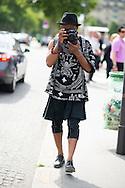 Photographer in a Kilt and Leggings, Outside Christian Dior
