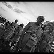 Buddhist monks and other gather at Bangkok's Wat Dhammakaya during ceremonies for XXXXX day.  The event marks the most holy day in Buddhism honoring the birth, death, and enlightenment of the Buddha.  (photo by David Longstreath)