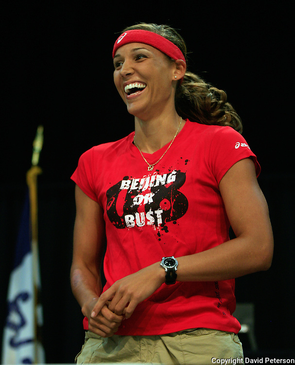 Olympian LoLo Jones, breaks into a big smile at a July 14th Beijing send-off for her, and fellow Iowan Shawn Johnson, held in Des Moines, Iowa.  ..Jones, a Des Moines native, won the 100 meter hurdles at the U.S. Olympic Track & Field Trials in Eugene, Oregon, and will be a favorite to win a gold medal in the event at the Olympic Games in Beijing, China, in August.  photo by David Peterson Olympics,Des Moines,send-off,rally,Shawn Johnson,track&field,100 meter hurdles,excited,happy,smile,coach,sport,Beijing,China,Iowa,celebration,gymnastics,flood,gold medal,winner,compete,America,Liang Chow