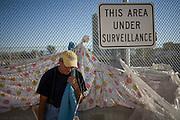 RENO, NV - OCTOBER 6:  Mike Moore stands in a tent city for the homeless in downtown Reno, Nevada before being evicted with all other men October 6, 2008. The City of Reno set up the tent city when existing shelters became overcrowded as Nevada struggles with one of the highest unemployment rates in the country. (Photo by Max Whittaker/Getty Images)