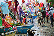 Decorated boats moored along the beach at the Maulid Nabi festival, Cikoang, Sulawesi, Indonesia.