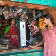CAPTION: Using a loan from her local self-help group (SHG), Shivamma has set up a petty shop to help cover the costs associated with her daughter Saraswathi's learning disability. LOCATION: Mangala Hosuru (village), Kasaba (hobli), Chamrajnagar (district), Karnataka (state), India. INDIVIDUAL(S) PHOTOGRAPHED: Shivamma (left) and Saraswathi (right).
