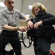 Master Sergeant Adam B. Ringle (LEFT) assist registered nurse Kelly Green-O'shaughnessy (RIGHT) with the Tactical vest in the course of an Active Shooter workshop Sunday, Mar 16, 2014 Christina Hospital in Newark Delaware.