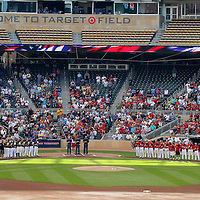 MINNEAPOLIS, MN- JUNE 19: (From Left) The Burnsville Blaze and the Eden Prairie Eagles line up for the National Anthem at the  the 2010 Minnesota State High School League Class 3A Championships at Target Field in Minneapolis, MN on Saturday June 19, 2010. This is the first time that the MSHSL tournament was held at the newly opened Target Field.(Photo by Adam M. Bettcher)