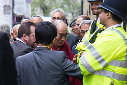 "London, September 21st, 2015. The Dalai Lama, who is on a visit to Britain, arrives amid anti-discrimination protests by Shugden Bhuddists, at the Lyceum Theatre in Covent Garden to host ""An Afternoon with the Dalai Lama and Friends""."
