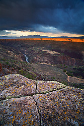 Sunset on the rim of the Rio Grande River Gorge near Taos, New Mexico.