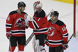 Apr 3; Newark, NJ, USA; New Jersey Devils defenseman Andy Greene (6) congratulates New Jersey Devils goalie Johan Hedberg (1) after their 3-1 win over the New York Islanders at the Prudential Center.
