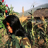 A female Maoist rebel of the PLA, or People?s Liberation Army, in a remote part of western Nepal controlled by the Maoist rebels. (Photo/Scott Dalton)