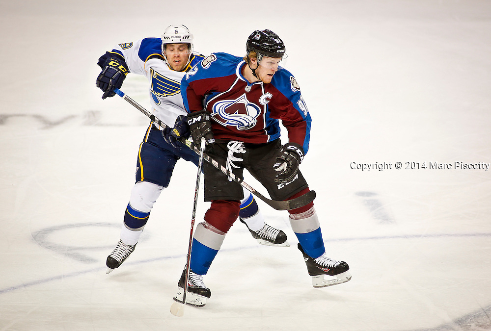 SHOT 3/8/14 2:19:25 PM - The Colorado Avalanche's Gabriel Landeskog #92 gets tied up by the St. Louis Blues' Jaden Schwartz #9 during their regular season Western Conference game at the Pepsi Center in Denver, Co. The Blues won the game 2-1.<br /> (Photo by Marc Piscotty / &copy; 2014)