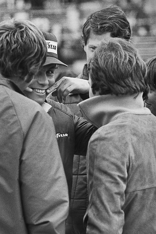 The bonds of brotherhood. <br /> <br /> French Formula One driver Patrick Tambay jokes with Gilles Villeneuve and wife Joanne about the challenge of keeping a smile while struggling with his car at the 1977 United States Grand Prix. <br /> <br /> Villeneuve was visiting the pit lane during race practice, familiarizing himself with the atmosphere. He would join Scuderia Ferrari the next weekend in Canada as replacement for two-time World Champion Niki Lauda. Although Tambay would fail to qualify the Ensign-Ford at the Glen, he would fare much better in Canada, finishing a remarkable fifth.<br /> <br /> Patrick Tambay's deep bonds with Villeneuve lay beyond the racetrack. He was godfather to Villeneuve's young son, Jacques, who would eventually become the 1997 Formula One Champion with Williams.<br /> <br /> For the 1978 season, Tambay would move to McLaren while Gilles Villeneuve would rapidly become a Ferrari hero and world-wide celebrity. Tragically, Gilles would never win the world championship, but instead die heartbreakingly in a practice accident at the 1982 Belgian Grand Prix. <br /> <br /> It would be his great friend Patrick Tambay who would receive the call from Enzo Ferrari to replace Villeneuve. Ferrari knew that Tambay would never let his dear friend's memory down. <br /> <br /> Patrick quickly proved he never had any doubts, courageously winning the German Grand Prix that same summer and placing the victor's wreath on Gilles&rsquo; Ferrari number 27.<br /> <br /> Brothers bonded forever, indeed.