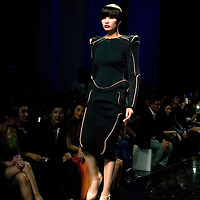 BEIJING, MAY 11, 2012 : models walk down a catwalk during a Jean-Paul Gaultier fashion  show in Beijing.