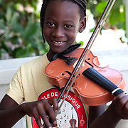 A violin student shares a smile during her lesson.