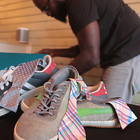 Al Olokunola sets up a display of sneakers during Sneaker Jam Sunday July 20, 2014 at Carolina Club 1880 in Wilmington, N.C. The event offered sneaker collectors the opportunity to purchase and trade new and rare shoes. (Jason A. Frizzelle)