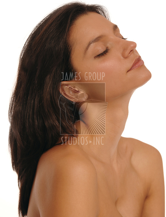 Medium shot of a beautiful, young, brunette woman relaxing after a spa treatment