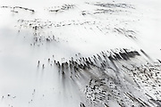 Deposits of soot, ash and dust mar the surface of the Vatnajökull Glacier, July, 2014. The Vatnajökull Glacier loses 40m a year, and pollution like this absorbs heat from the sun and accelerates the process of deglaciation.