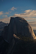 Half Dome under moonlight and stars seen from Glacier Point - Yosemite National Park, California