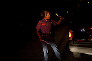 Officer Claudia Gonzalez makes a routine traffic stop on August 19, 2010 in Laredo, Texas. Laredo has been beefing up its police force to deal with the possibility of spillover violence, but crime remains relatively low with only six murders this year. City officials say negative attitudes about the city's more dangerous sister Nuevo Laredo have kept tourists from coming and effected the over all economics of the town.