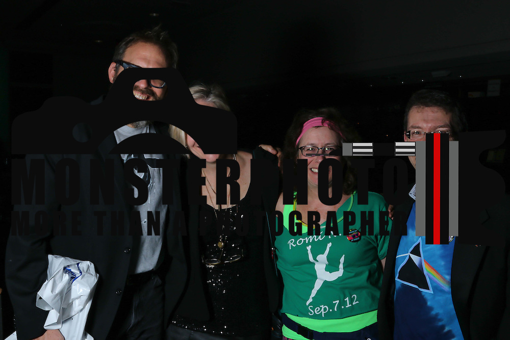 From Left Craig and Rebecca Newschaffer, Frances Ratner and Steve Biener poses for a photo during the Autism Delaware Back to the '80s gala Saturday, Nov. 21, 2015 at World Cafe Live at the Queen in Wilmington.