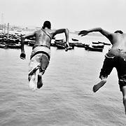 Boys playing in a mole of the small port of Tarfaya, a village that is being buried by the sand of the Sahara desert(July 2009).<br /> <br /> Unos chicos jugando en un muelle del peque&ntilde;o puerto de Tarfaya, pueblo que las arenas del S&aacute;hara estan engullendo (julio 2009).