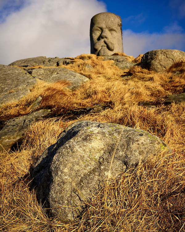 Stone at Knudaheio with the monument of Arne Garborg in the background, Rogaland, Norway.