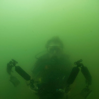 Underwater Photographer in bad visability, Miri, Sarawak, Malaysia, Borneo, South China Sea,