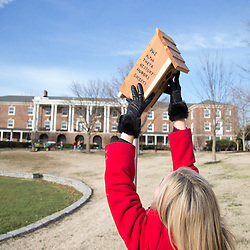 APSU graduate student Deanna Carter hangs a birdhouse on campus as it is designated a national wildlife habitat.