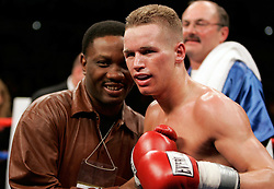 Undefeated featherweight Jason Litzau with Pernell Whitaker after his bout against Carlos Contreras.  Litzau stopped Contreras in the 6th round.  The bout took place on the undercard of the Arturo Gatti vs Thomas Damgaard IBA Welterweight Championship bout at Boardwalk Hall in Atlantic City, NJ.