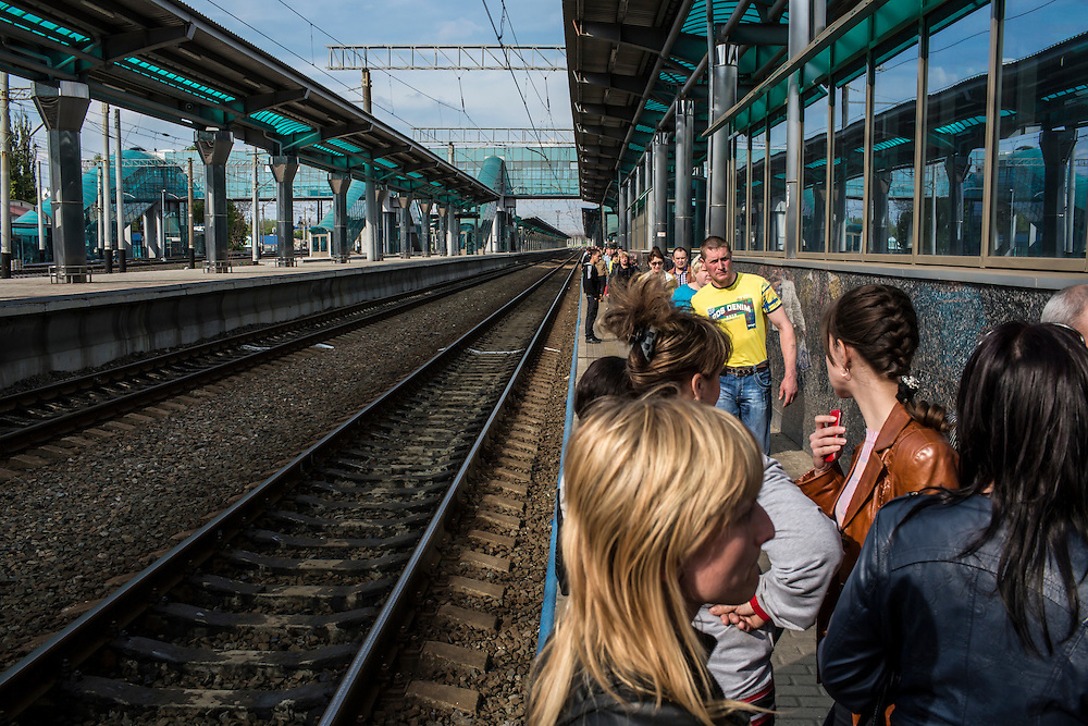 DONETSK, UKRAINE - MAY 4: People stand on a train platform at the Donetsk train station, where pro-Russian protesters descended after hearing a rumor that pro-Ukrainian nationalists were due to arrive on May 4, 2014 in Donetsk, Ukraine. Cities across Eastern Ukraine have been overtaken by pro-Russian protesters in recent weeks, leading the Ukrainian military to respond with force in some areas. (Photo by Brendan Hoffman for The Washington Post)